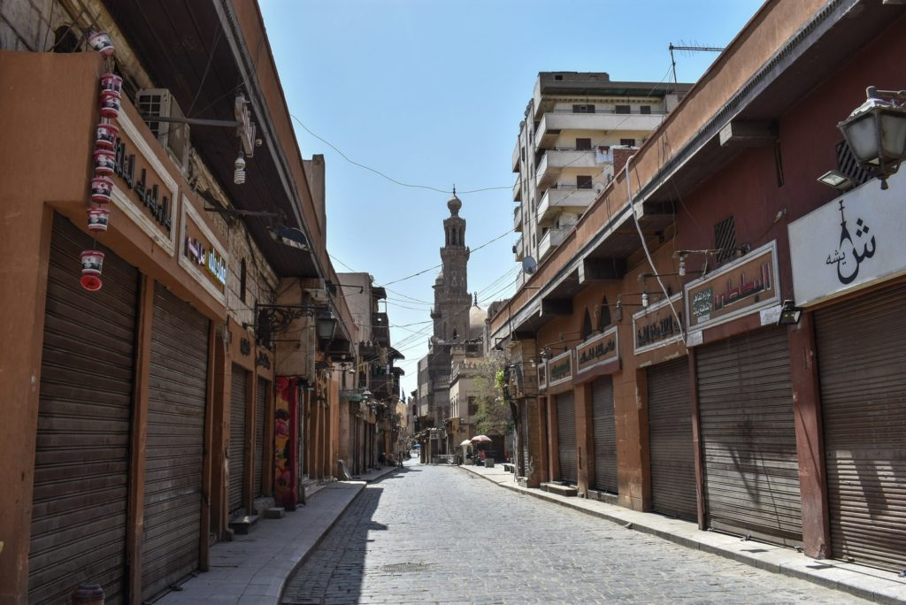 Stores were closed on Cairo's Al-Moez Street, where the Egyptian government imposed a two-week curfew, during which all public transportation in the city was suspended.Photo: Ziad Ahmed/NurPhoto via Getty Images