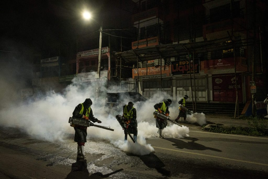 In Nairobi, Kenya, volunteers from Sonko Rescue Team, an NGO privately funded by Nairobi Governor Mike Sonko, fumigate a street on April 6 to curb the spread of COVID-19.Photo: Yasuyoshi Chiba / AFP via Getty Images