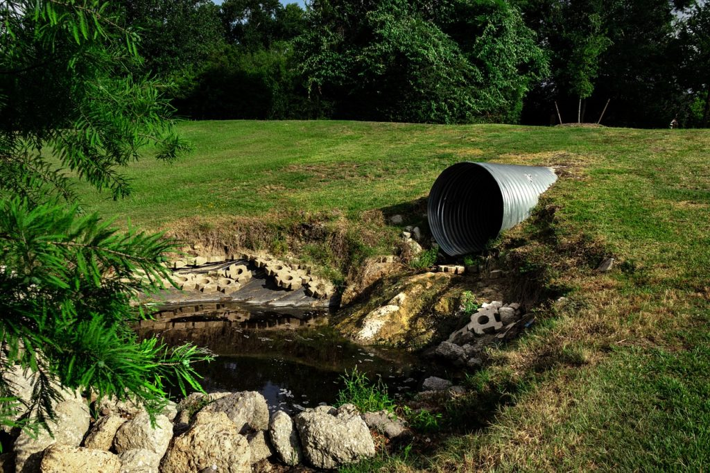 sewage pipe polluted water, environmental, erosion