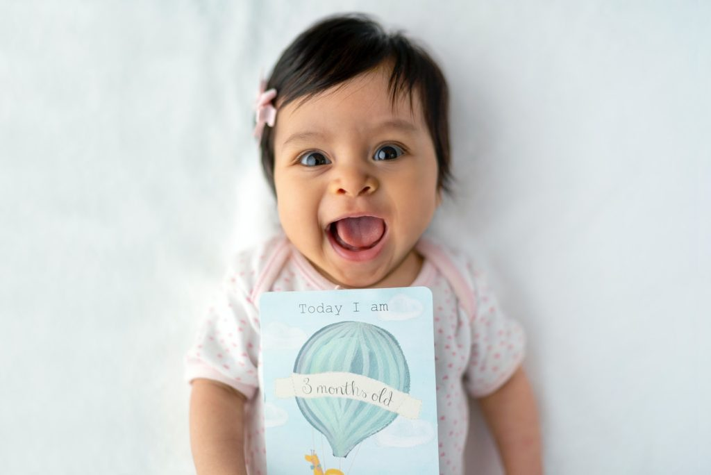 baby with 8 months old card